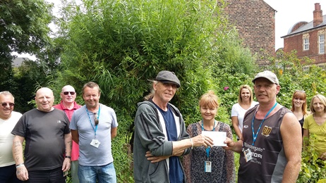Service users' allotment receives donation