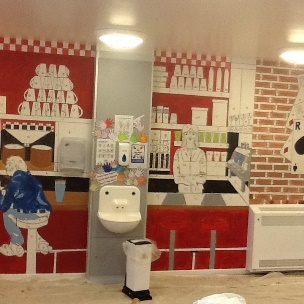 American diner mural transforms secure hospital's drab cafe walls